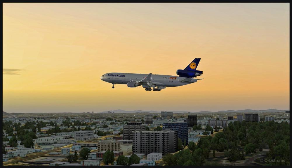 76404 MD-11 on final with sunset over San Diego copy.jpg